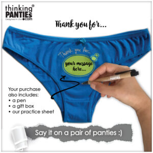 A pair of blue fun gift for friends, underwear you can write on. A gift or souvenir as means to deliver a message. There is a hand holding a pen to indicate the use of the product.