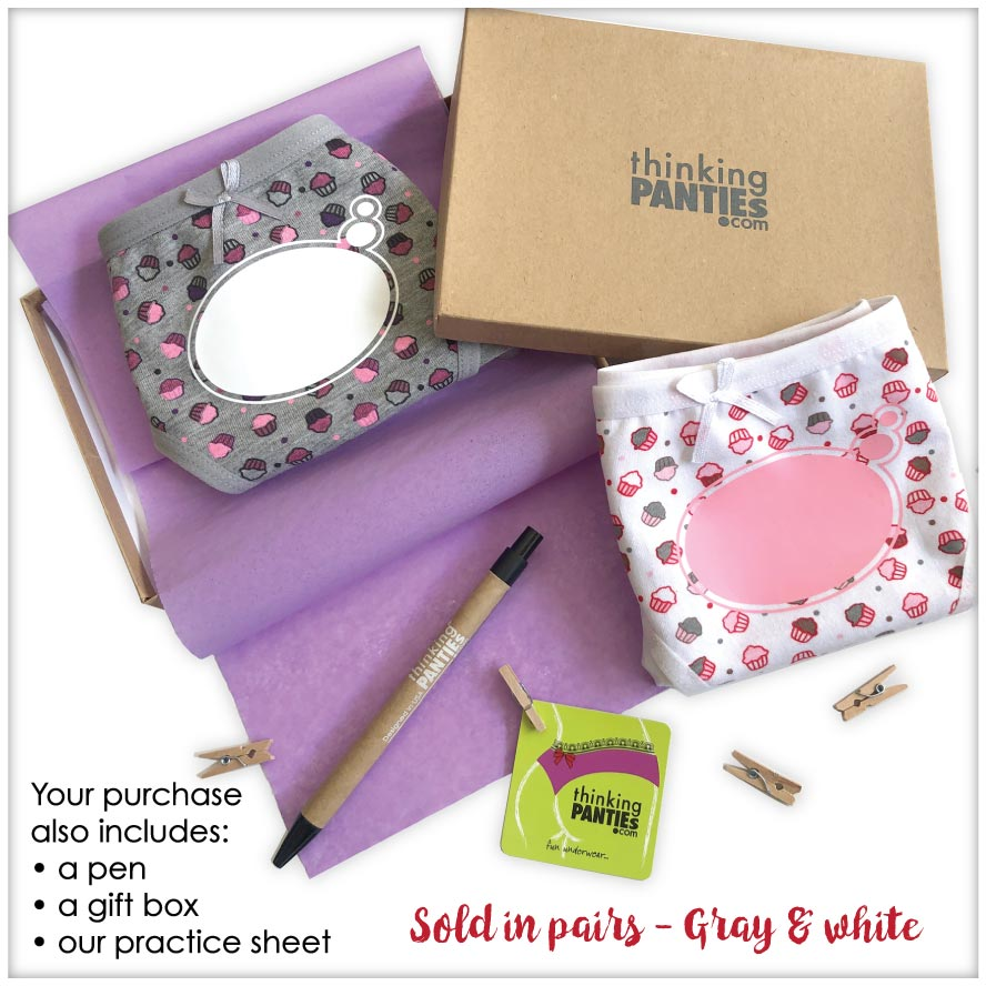 Two panties, with cupcakes pattern, a gift box and a pen with description of what the purchase includes