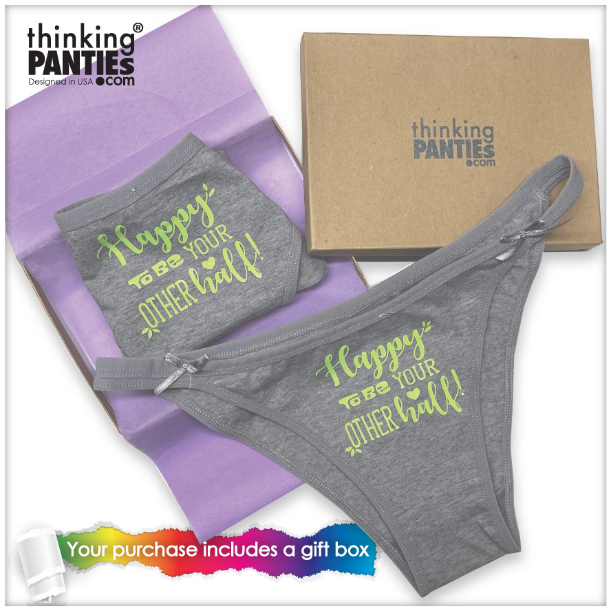 """two pair of gray statement underwear that say """"happy to be your other one."""" One panty is a bikini and the other one a Brazilian bikini.There is gift box by their side"""