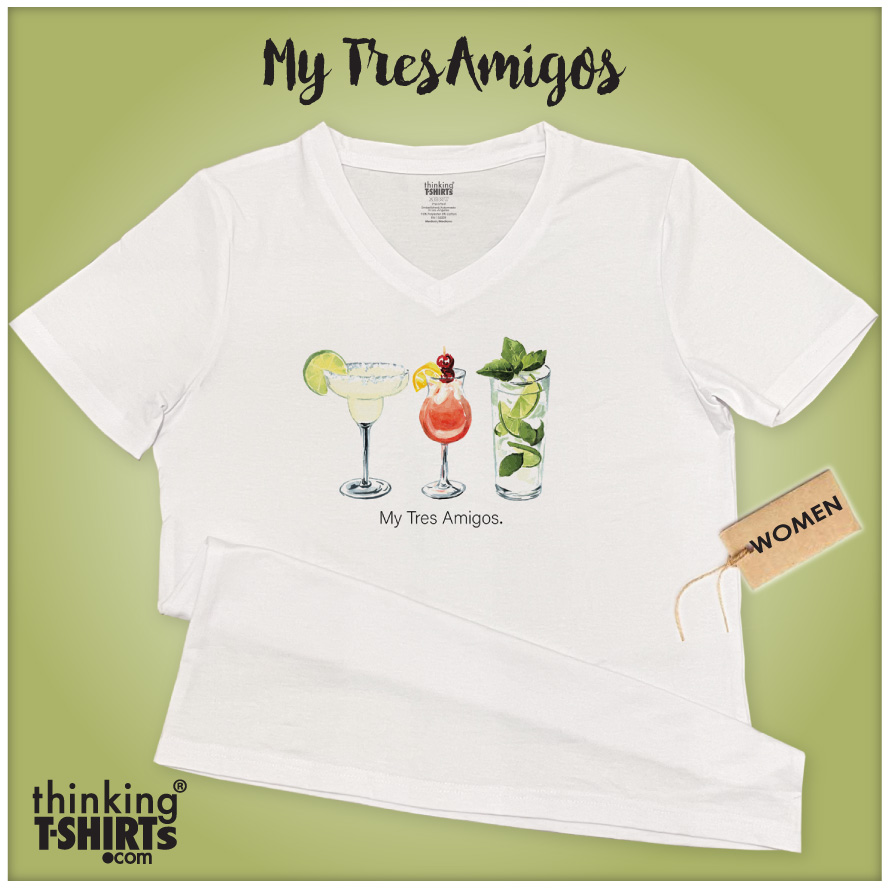 """White v-neck t-shirt with an illustration on chest area consisted of three different drinks. The garment is viewed on a green background. The inscription reads; """"My Tres Amigos."""""""